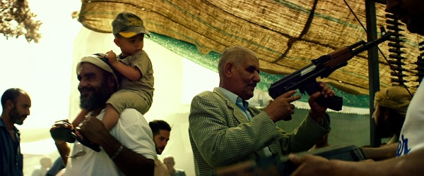 A potential buyer at the arms bazaar holds the rifle.