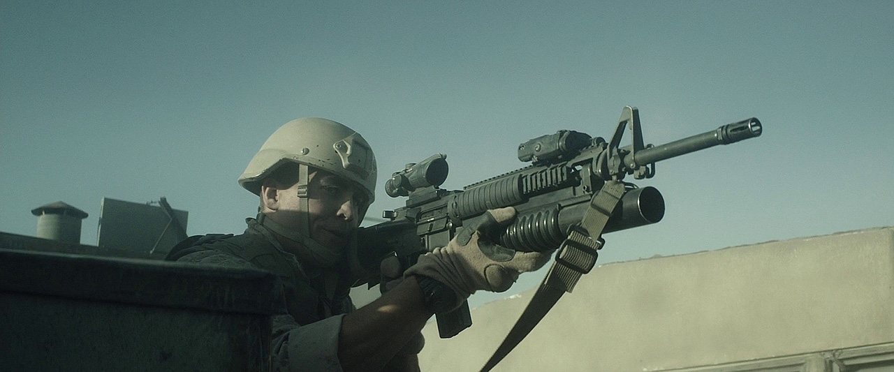 A Recon Marine with a M16A4 with an ACOG sight and an underslung M203.