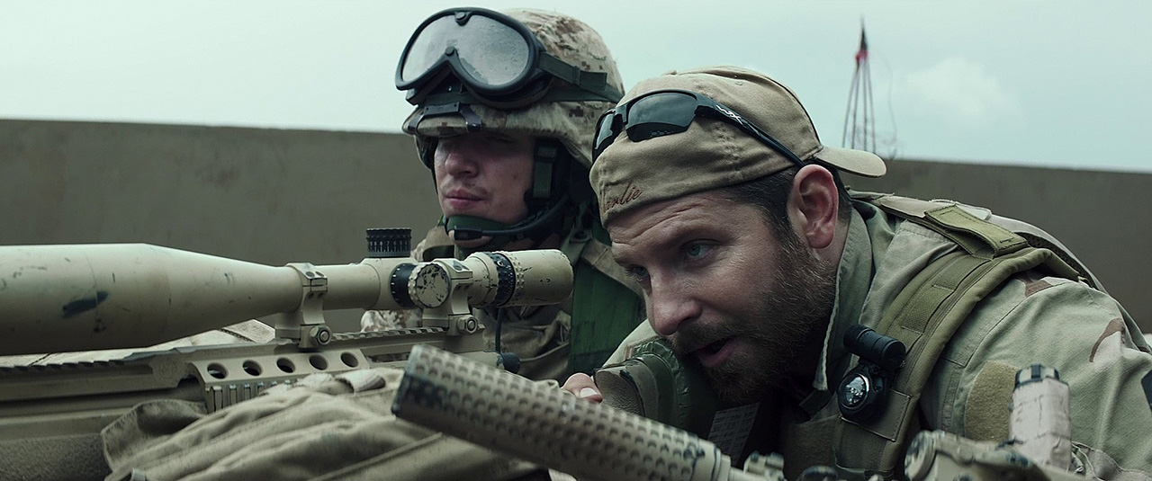 Chris Kyle (Bradley Cooper) takes aim with what appears to be an MK13 rifle, based off the Remington Model 700, chambered in 300 Winchester Magnum.