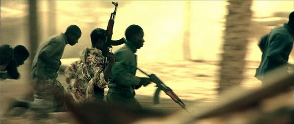 Somali militiamen running with AK rifles.
