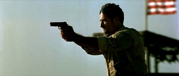 Delta Force MSG Wex (Kim Coates) shows the Rangers what a .45 can do.