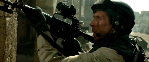 SFC Sanderson (William Fichtner) with a carbine.
