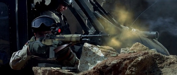 SFC Shughart fires his M14 in defense of the second crash site.