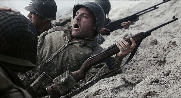"""Gather weapons and ammo!"" TSgt. Mike Horvath (Tom Sizemore) with his M1 Carbine on Omaha Beach, Dog Green Sector."