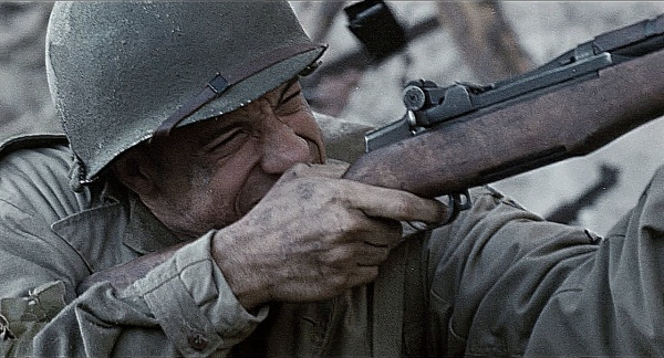 *PING!* Private Adrian Caparzo (Vin Diesel) fires his M1 Garand. The ejected empty en bloc clip can be seen in this shot.