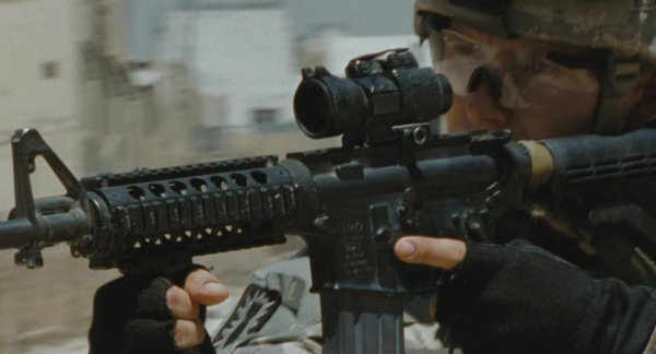 Specialist Eldridge (Brian Geraghty) with his M4 in the opening scene. Clearly visible on the magazine well (if the image is enlarged to full-size) is the symbol for LMT (Lewis Machine & Tool), an AR-15 manufacturer based in Illinois.